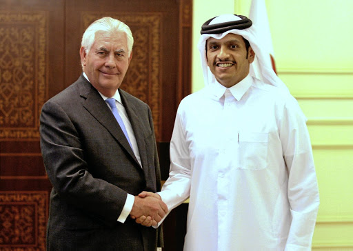 Qatar's foreign minister Sheikh Mohammed bin Abdulrahman al-Thani, right, shakes hands with US secretary of state Rex Tillerson following a joint news conference in Doha, Qatar, on July 11 2017. Picture: Reuters/Naseem Zeitoon