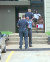 """Photo: What advice did I give the Maintance Man's son (Seated on 2nd Step NO SHIRT) when this Tyler PD Detntion was over (Investigating a Assault-ie Fight)  """" Get The Police Report and Were They Courteous and Respectful and did They have Reasonable Criminial Suspicion and Probable Cause.? """"  For Instance The Rodney King Video was Shot From a Second Story Balcony of a Apt Complex  (Private Proprerty) onto PUBLIC PROPERTY where LAPD Officer Stacy Konn That White Rascit GOON has No Reasonable Expectaion Of Privacy.. Insde a Mall LIke The SW Center Mall (Private Property) Unless There is a Sign stating No Photogrphy on Premies If you have Permision t Enter You have Permission to Shoot- UNLESS The Subject Has a Reasonable Expectaion of Privacy like a Barthroom or Dressing Room. If Mangement of The Burlington Coat Factory- Gives a Case and Desit orcder on Private Property You have to Stop Shooting. but The Common Area of The Mall and Other stores are Still PERMISSIBLE .. The Parking Lot is PERM"""