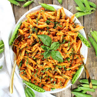 Spicy Chicken Pasta and Peas with Sun-Dried Tomato Sauce.
