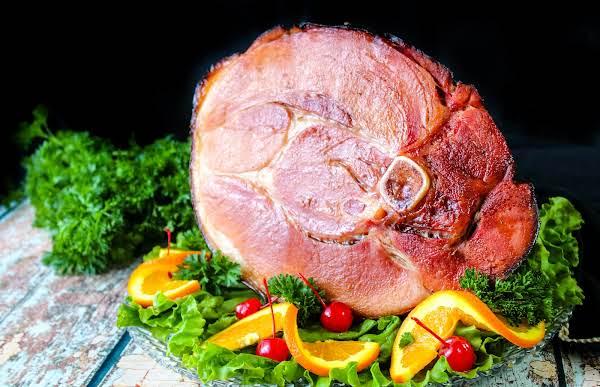 Whiskey Wild Cherry Coke Glazed Ham Ready To Be Sliced.