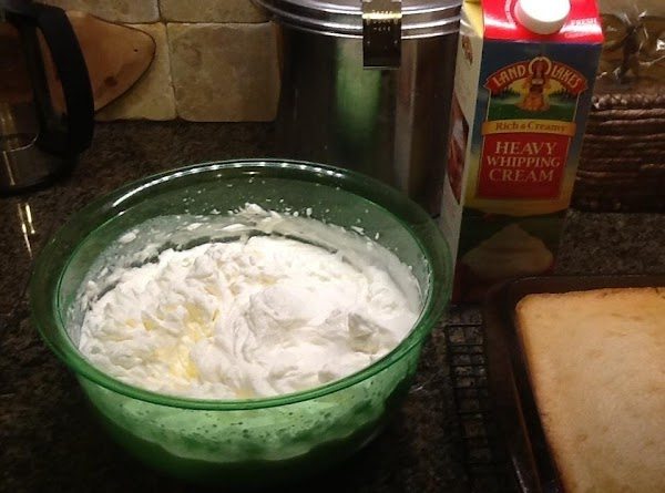 Pour your whipping cream, sugar and butter flavor into a mixing bowl and beat...