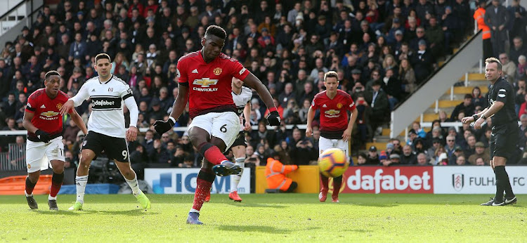 Paul Pogba scores Manchester United's third goal during their Premier League match against Fulham FC at Craven Cottage on Saturday. Pogba scored twice in a 3-0 rout of the relegation troubled Fulham.