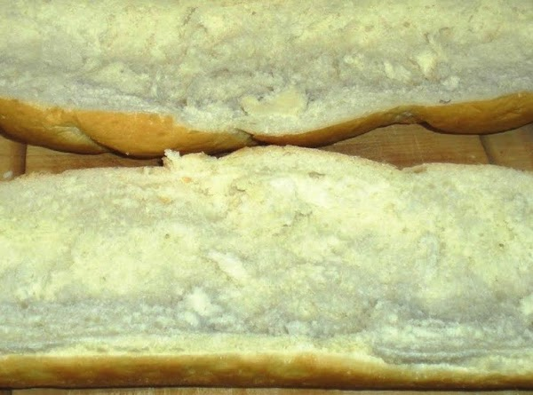 Slice French bread in half lengthwise and scoop out the inside of the loaf....
