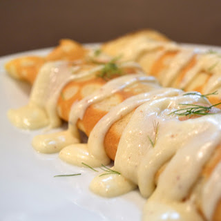 Smoked Salmon Stuffed Crepes with Bechamel Sauce.