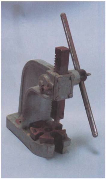 An arbor press is generally necessary to press bearings on and off of shafts, but you can improvise a European-style workbench into an arbor press.