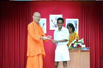 Photo: Aresh Kumanan (PSLE) receiving the Award from Swamiji