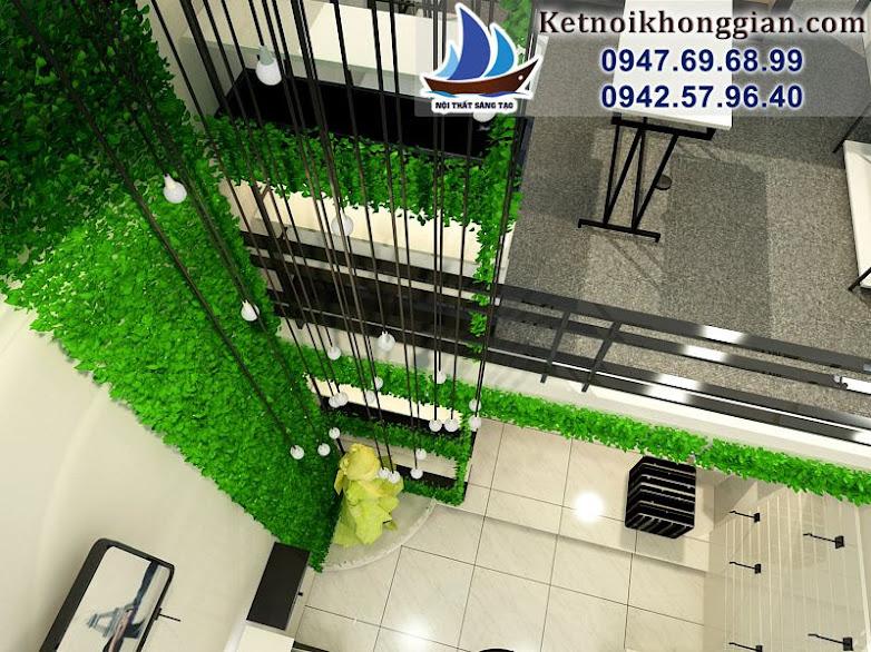 thiết kế cửa hàng thời trang nữ có cỏ xanh