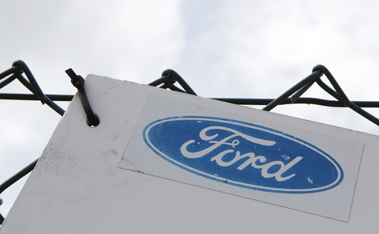 A sign on a fence at Ford's stamping operations in Dagenham, London. Picture: REUTERS