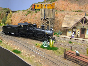 """Photo: 024 A 30"""" gauge oil-fired 2-8-0 waits for its next turn of duty whilst on the high level line an Australian coffee-pot steam railcar shows that it is quite at home in the USA on the Texas, Santa Fe and Northern Railroad."""