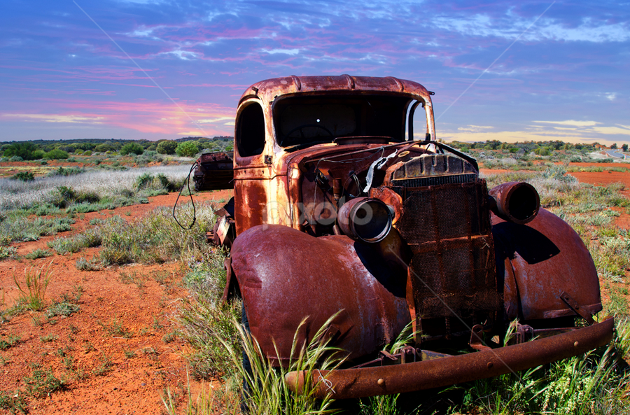 A rusty old pick-up truck sits derelict in a field by Loredana  Smith - Landscapes Travel ( old, truck, automobile, neglect, menzies, pick up, rustic, forgotten, junk, aged, worn out, transport, derelict, rust, classic, western australia, desert, overgrown, vintage, wreck, rural, field, broken, antique, abandoned, decay )