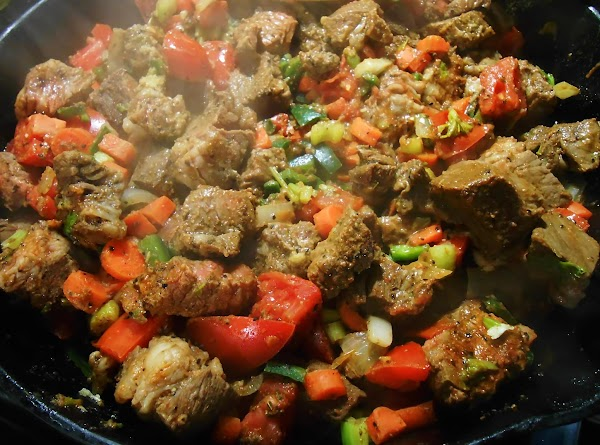 Cut roast into preferred size cubes.  Place in a large oven proof skillet...