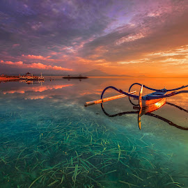 Golden Hour of Sanur Beach  by Bertoni Siswanto - Landscapes Sunsets & Sunrises ( landscapes, landscape photography, sunrise, reflections, canon eos, indonesia, boat, transportation, canon, travel photography, morning glory, bali, seascapes, travel )