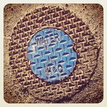 Photo: Maple Ridge water system cover, nice assorted colors on the sidewalk #intercer #walk #water #street #city #fall #urban #design #town #design #britishcolumbia #canada #pretty #brown #structure #sidewalk #cover #mapleridge #blue #pattern #lines #system #shape #circle #gravel #wheel - via Instagram, http://instagr.am/p/Q_kqJupfqU/