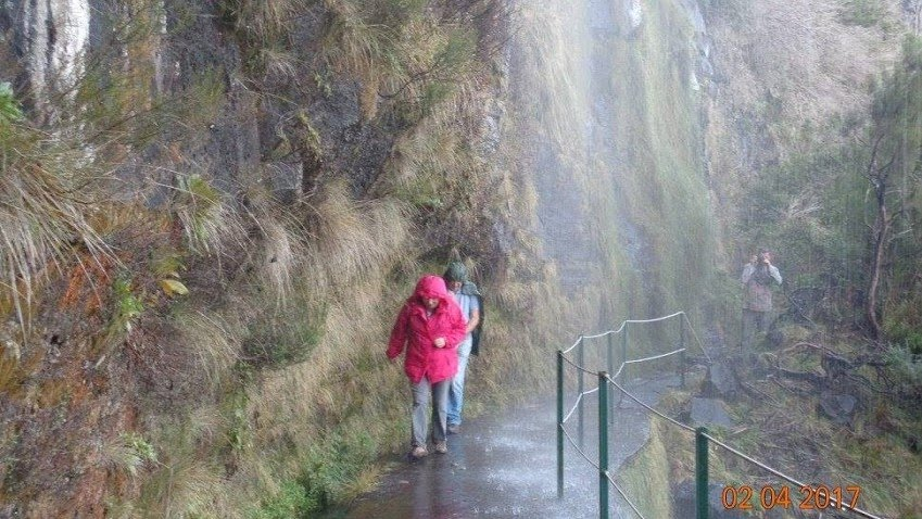 Everybody soaked. Note that the levada runs underneath the pavement here.