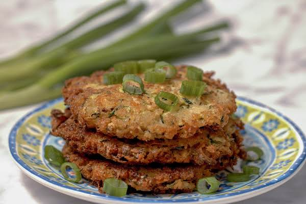 A Stack Of Zucchini Fritters On A Plate.