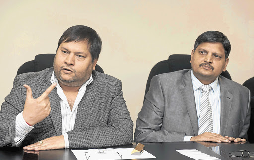 Businessmen Ajay Gupta and his younger brother Atul.
