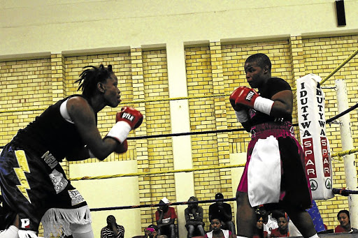Mapule Ngubane , left, with  Rita 'Shot Gun' Mrwebi during a fight  in Butterworth, Eastern Cape. Ngubane will take on Slovenian Ema 'The Princess' Kozin in Oklahoma City in the US in March. /   SINO MAJANGAZA