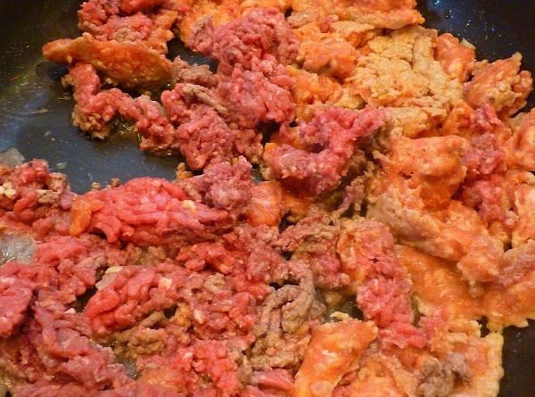 In skillet on medium high heat brown pork sausage and ground meat until it...