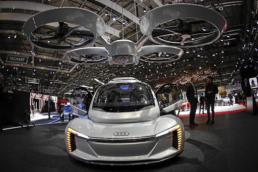 Is it a plane, is it a pain? The Audi Pop.Up Next AG pop.up next self-driving automobile and passenger drone at the 88th Geneva International Motor Show. Picture: Bloomberg/Stefan Wermuth