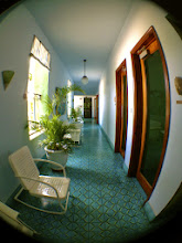 Photo: The gorgeous tile and fun chairs down the hallway towards the photo shop.