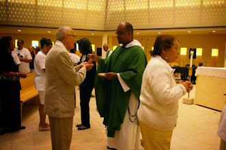 Photo: Father Jeffery Ott, O.P. distributes communion to the Associates present at Mass on Saturday morning.