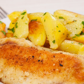 Baked Fish and Potatoes with Rosemary and Garlic
