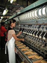 Photo: factory worker spinning silk threads from coccoons, Pak Thong Chai silk factory