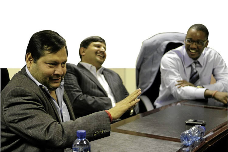 Duduzane Zuma, right, with Ajay and Atul Gupta in the offices of their newspaper, The New Age, in Midrand, Gauteng, in 2011.