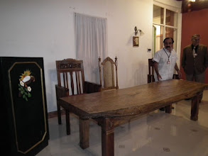 Photo: Puji admires the massive single block of wood that forms the table top