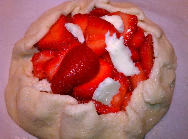 Fold up the edges of the dough over the berries, just at the edge,...