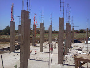 Photo: Now more structual columns are going up to support second level as well as support for interior and exterior walls.