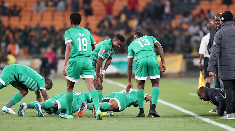 Bloemfontein Celtic striker Ndumiso Mabena celebrates with teammates by doing push ups during the Absa Premiership match against Kaizer Chiefs at the FNB Stadium, Johannesburg on August 29, 2018.
