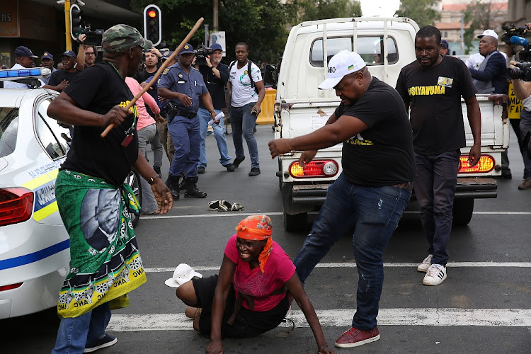 Thabang Setona, who is the ANC branch secretary of Ward 62, is seen assaulting a woman , who was riding on the back of a vehicle.