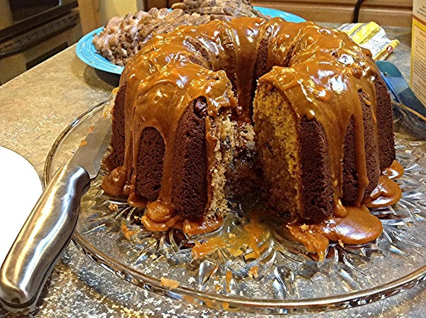 Drizzle glaze over cake, add additional nuts if desired. Serve and enjoy. You may...