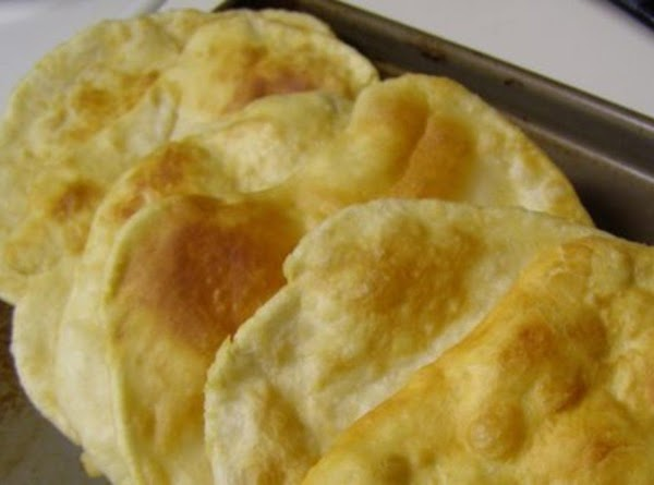 General photo of fried dough via the internet, source/origin of photo unknown.  Photo was NOT taken by me but depicts the finished product of fried dough/tortilla like used in this recipe.