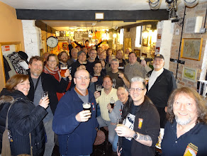 Photo: On our way back to Sheffield from Batemans, we made a pit stop at the amazing Just Beer Micropub in Newark. In the photo, the group packs into this small pub that offers only fine real ale. Owner Phil Ayling is pictured on the front row to the right of Owen Ogletree.