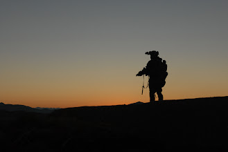 Photo: A U.S. Army Special Forces Soldier, with Special Operations Task Force – South, scans the horizon for enemy activity in Shah Wali Kot District, Kandahar Province, Afghanistan during a clearing operation Feb. 8, 2011 alongside Afghan Commandos from 2nd Company, 3rd Commando Kandak.  The commandos, along with District Chief of Police, Bacha Khan, detained 20 suspected insurgents for questioning.  The partnered units also found 80 pounds of homemade explosives and various improvised explosive device making components on the operation. (U.S. Army photo by Staff Sgt. Jeremy D. Crisp)(Released).