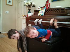 Photo: Boys Play Piano With Their Feet