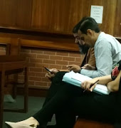 Farhad Hoomer and his attorney Yusuf Cassim in the Verulam Magistrate's Court on Monday.