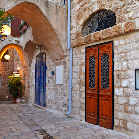 Capricorn street by Natalie Ax - City,  Street & Park  Street Scenes ( door, middle, city, old, jaffa, historical, tourism, traveling, stone, east, cobblestone, middle east, street, israel, paving stone, antique, alley, travel, old city, lights )