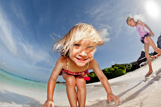 """Photo: Photographing kids on a beach is almost """"catch me if you can"""" game:-) This time I've got her, almost blindly pointing camera to her. I could only wish to get her feet in frame. This is Cancun, Mexico  P.S Forgot to add: I've used camera mounted Canon speedlite with +1 EV correction to fight the sun, which was in front of me (see right top corner, here it is:-). Exposure compensation were dialed -1EV."""