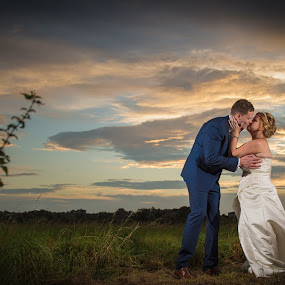 a kiss on a field by Marek Kuzlik - Wedding Bride & Groom ( wedding photography in west midlands, mk wedding photography, west midlans wedding photgrapher, marek kuzlik photography )