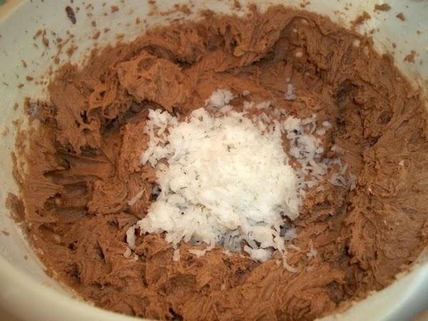 Stir in coconut. Drop by spoonfuls onto prepared baking sheet.