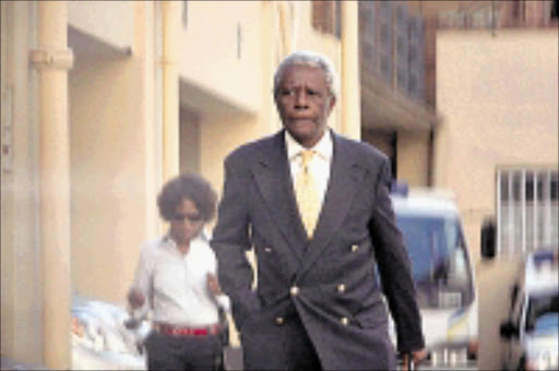 Drunken driving accused Judge Nkola Motata is seen outside the Johannesburg Magistrate's Court, Monday, 16 March 2009. The case was postponed to April 24th. Motata apologised to the court for the delay in the case which has been dragging on since he crashed his Jaguar into a wall of a house in Hurlingham, Johannesburg in January 2007, allegedly while drunk.Picture: Werner Beukes/SAPA
