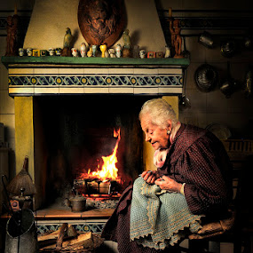 Dear cat... Once upon a time... by Alberto Ghizzi Panizza - People Portraits of Women ( look, story, gandmother, cat, od, tale, fireplace, fable, grandma, fire, country, aged )