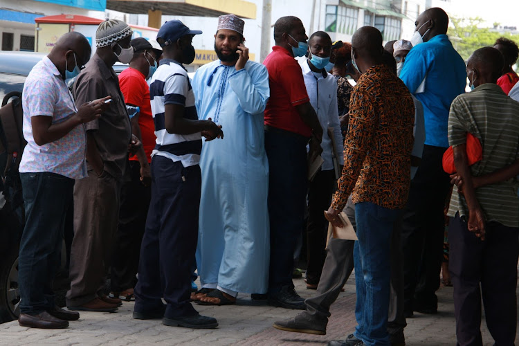 Aspirants for various Dock Workers Union positions outside the union's Makuli Fagia offices along Jomo Kenyatta Avenue in Mombasa on Wednesday, April 21, 2021