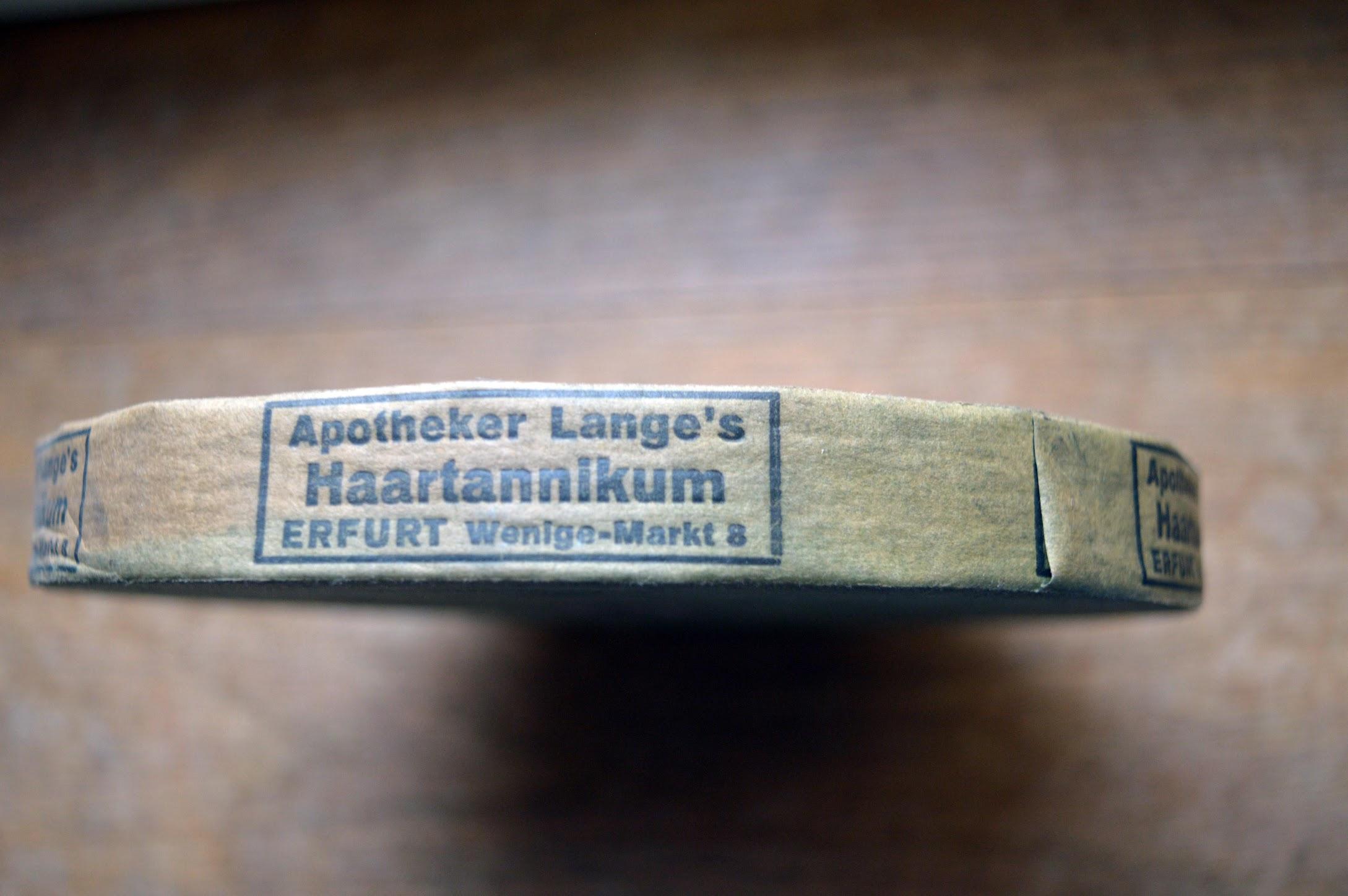 Packband, 1920, Germania-Drogerie Erfurt, Werbung für Apotheker Lange's Haartannikum