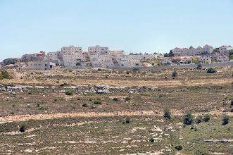 Photo: Working under the view of a Jewish settlement