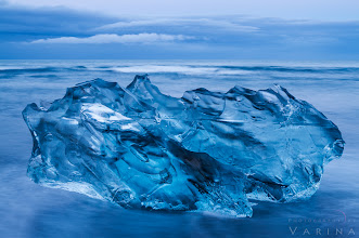 Photo: Ice in the Night  Do you think it's all be done before? Here's why I don't believe that.  This is a shot from Jökulsárlón in Iceland. I took the shot in the middle of the night, in the short space between a midnight sunset and a 3am sunrise. The world seemed completely blue. This large chunk of ice broke off an iceberg, floated from a beautiful lagoon to the sea, and washed up on the beach. As I watched, waves crashed against it, smoothing its surface and constantly changing the patterns of shadow and light that danced through it. It was mesmerizing.  This is a location that we returned to again and again. Each time we visited, it was completely different. Sometimes, the beach was free of ice... and then, moments later, an ice-jam would break up, and huge chunks of ice would sail down the river and out to sea as if on an urgent mission. They smashed into one another with such force that they broke into pieces... some as big as cars. And then they washed up onto the beach, where they rocked gently in the waves. At night, the colors were muted and blue. At sunrise and sunset, the ice glowed with color. When the sun was high in the sky, the light scattered through the ice with such intensity that it seemed it should melt.  Some places seem to gain an entirely new personality from one moment to the next - and others show much more subtle changes. But it's always worth coming back. If you can, return to a location repeatedly. Explore it in different conditions and get to know it's moods. There are so many variables. Changing seasons... changing light... different angles... rain and snow and mist. And of course, your options for cameras and lenses and filters and camera settings give you such a huge variety of creative control.  Lots of photographers I talk to feel that it's all been done before. They think that a location has been photographed so many times that there's absolutely no way to get a unique photograph. I don't believe that. I believe in getting to know the soul of a place. When you take the time to do that, you'll find that it is as changeable as the shifting patterns of light in this beautiful block of ice.  Now - of course, you can argue that you can't always visit a location over and over again. That's absolutely true. But if that's the case, go beyond the usual. Don't just stand at the overlook. Explore the place. Try different lenses. Look past the obvious. Inspiration is there. You just have to find it.