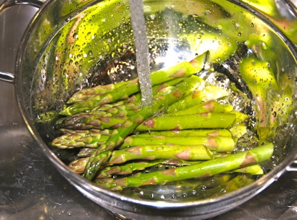 Preheat oven to 350 degrees.  Cut off white ends of asparagus, rinse and dry...
